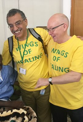 wings of healing volunteers with happy patient