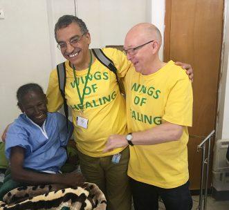 wings of healing volunteers with happy patient